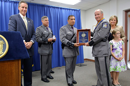 photo of Trooper Segur receiving award
